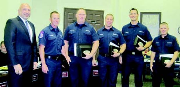 Members of the Forney Fire Department who made up the Forney Combat Challenge Team that recently competed and won several awards in Las Vagas were awarded the City of Forney's STAR Award Tuesday night. Left to right: Mayor Darren Rozell (award presenter); Ryan Elder, David Lawson, Tyler Sullivan, Russell Bannister, and Josh Everett. The group gave a detailed explanation of their competition and what it entailed.