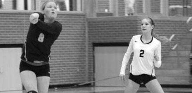 Forney's Kristin Silva (#8) and McKenzie Vernon (#2) play tough defense for the Lady Rabbits during play at the Forney ISD Volleyball Tournament this past weekend at Forney and North Forney High Schools.