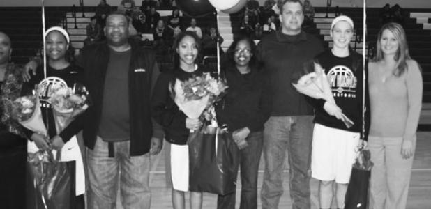 North Forney Lady Falcon basketball seniors and their families honored at their last home game Tuesday night at NFHS—From left to right, the seniors being recognized are Alaundria Norris (#34), Alexandria Webb (#14), and Emily Willey (#11) and their parents.