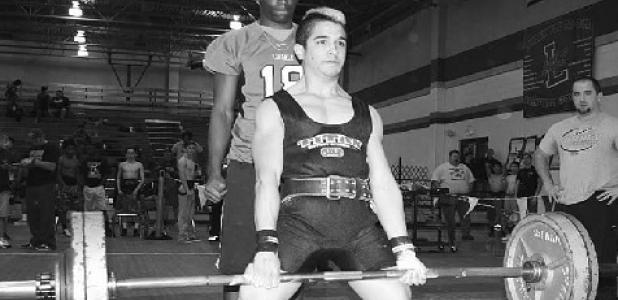 Forney's Joseph Rico dead lifts 370 pounds to win his 123 pound weight classification and earn a grip to the State Powerlifting Championships in Abilene later this month. This is Rico's second trip to the State Meet in this same weight classification during his high school powerlifting career. Coach Harley Pier watches Rico to the right.